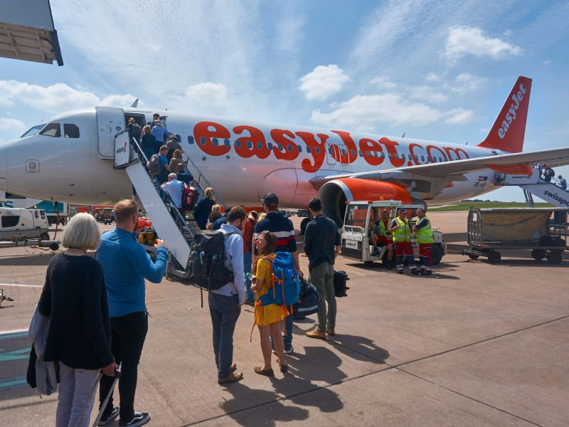 Bristol,uk:,20th,May,2018,-passengers,Queuing,And,Boarding,The,Easy